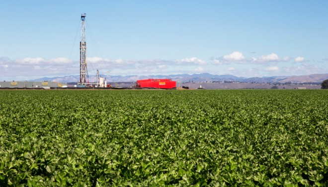 A oil drilling tower sits among celery plants near Santa Maria, Calif. Plans were recently approved for Santa Maria Energy to drill 381 new wells nearby.