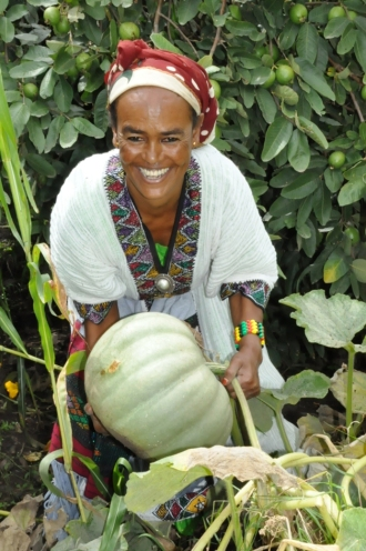 Birtukan Dagnachew holding a squash in her farm in the Woldiya District of the Amhara, Ethiopia