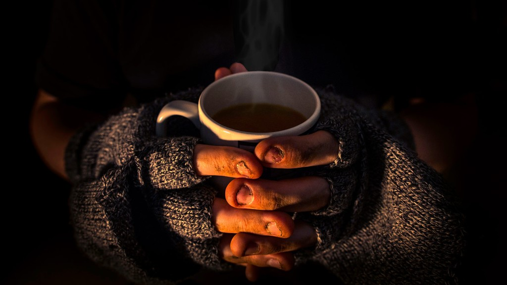 Homeless person holding a cup