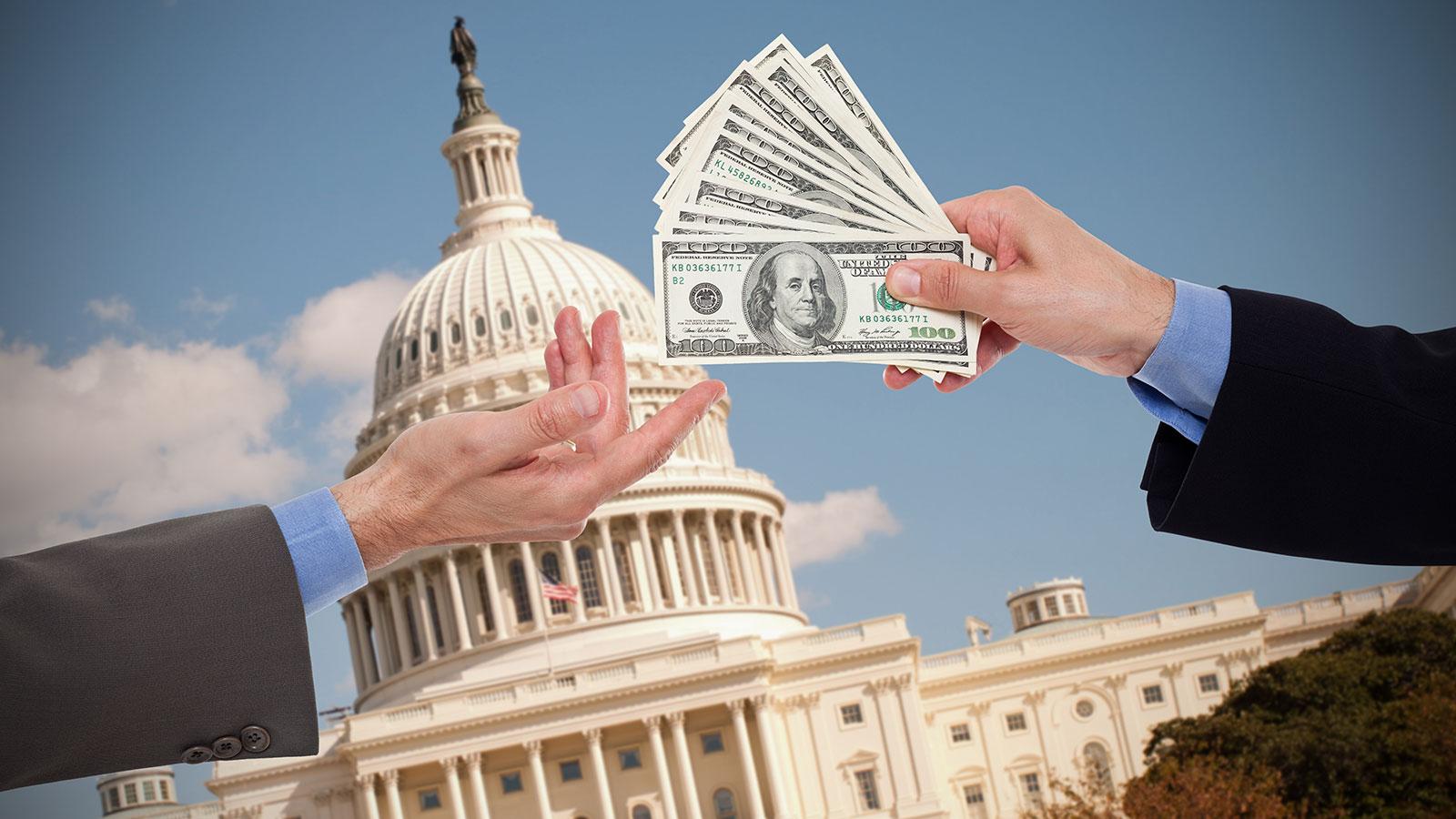 money handoff in front of Capitol