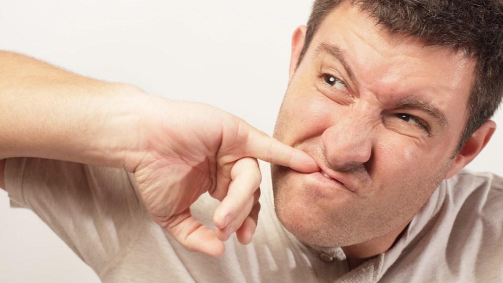 Man picking teeth