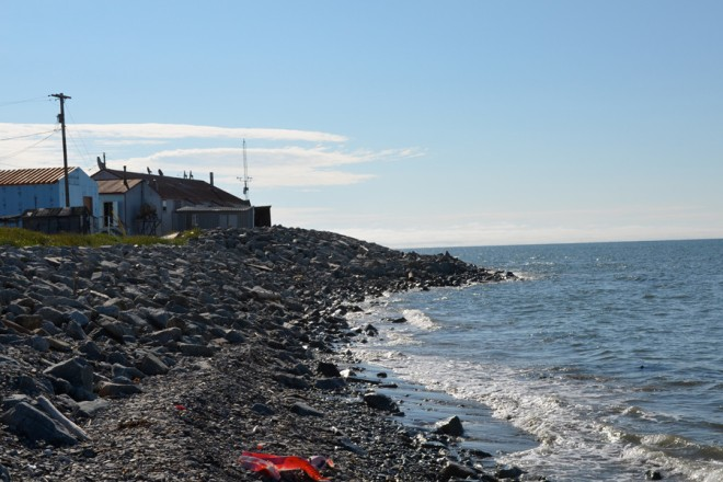 The residents of Shishmaref have moved houses away from the cliffs and constructed barriers, like this one, along the northern shore of the island to try to turn back the waves.