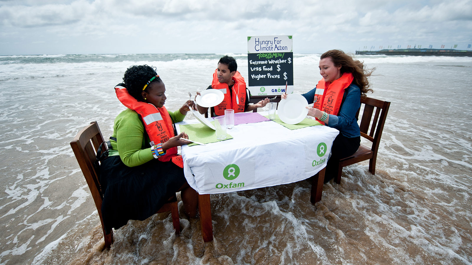 Climate activists at a table in the sea