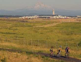 Bikers outside of PDX with Mt. Hood in the background