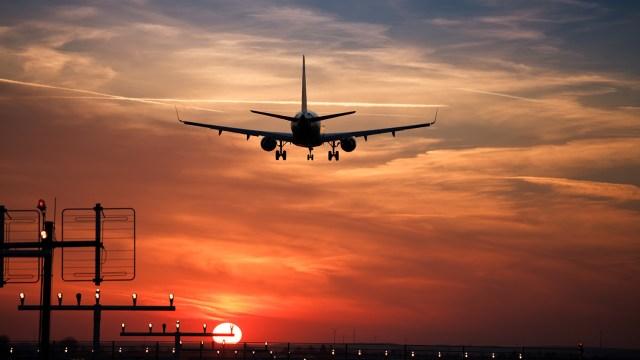 Sunset airplane landing