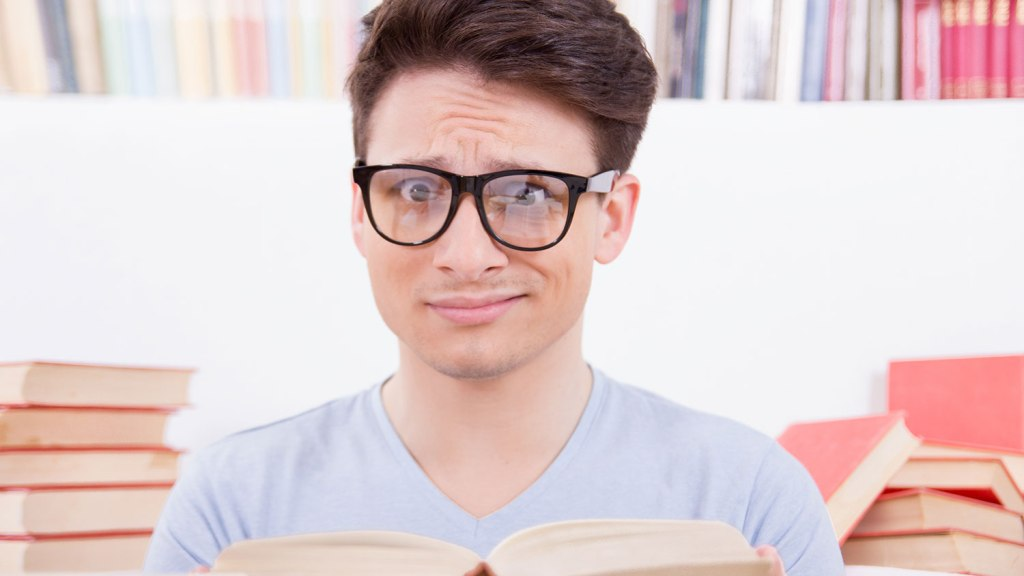 Confused student with books