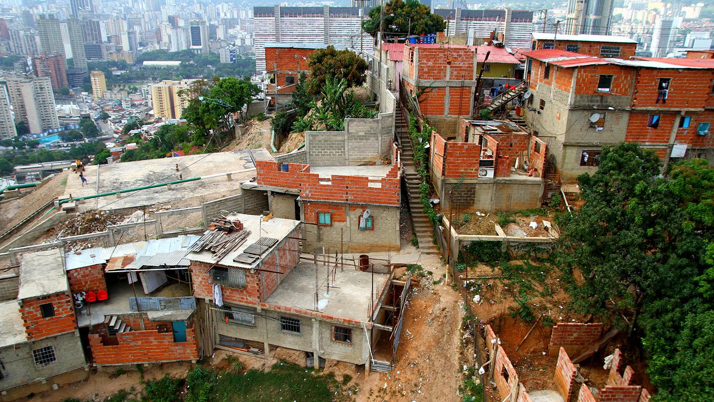 shanties in front of skyscrapers