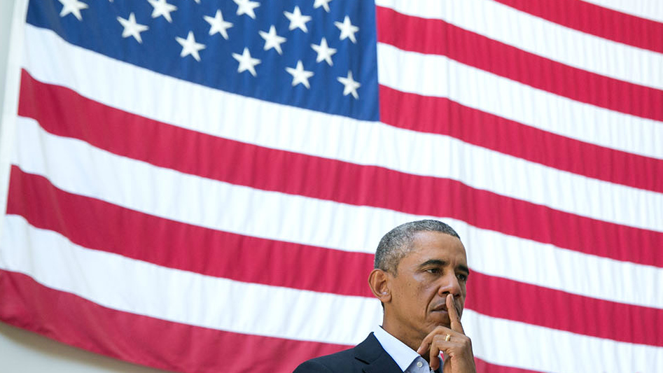 Obama in front of flag
