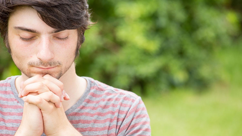 young guy praying