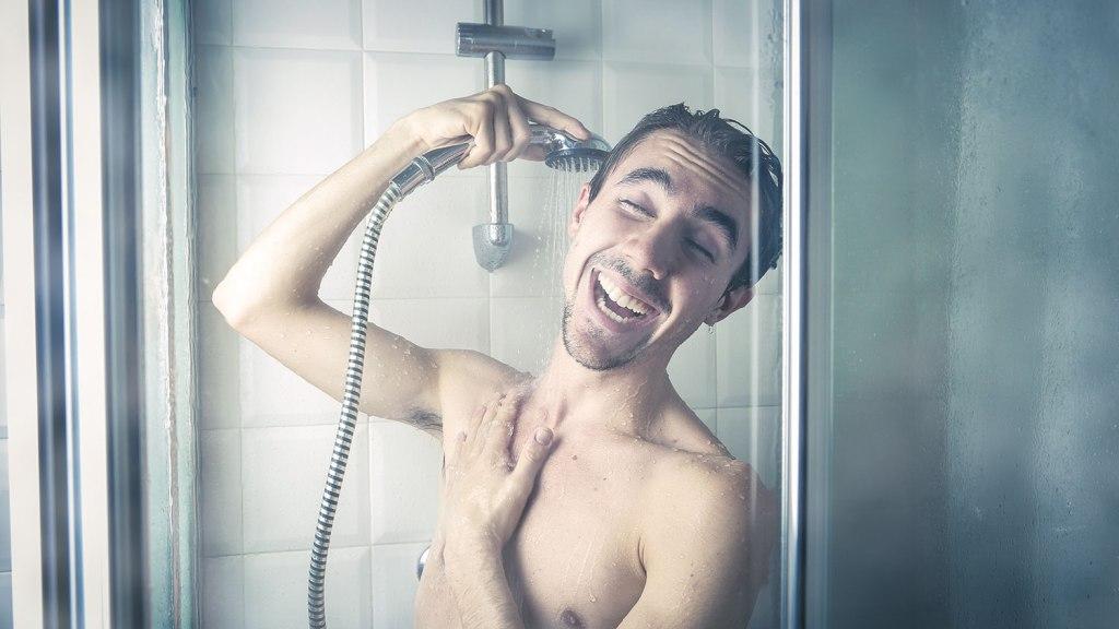 Happy man in steamy shower