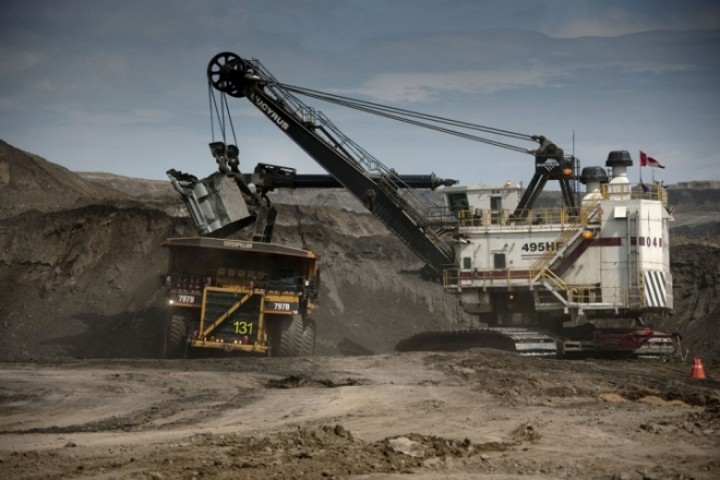 A digger extracting oil sands in Alberta.