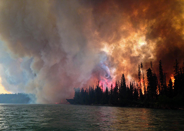 Fire burns at the Funny River area in the Kenai-Kodiak Area forest on May 25, 2014.