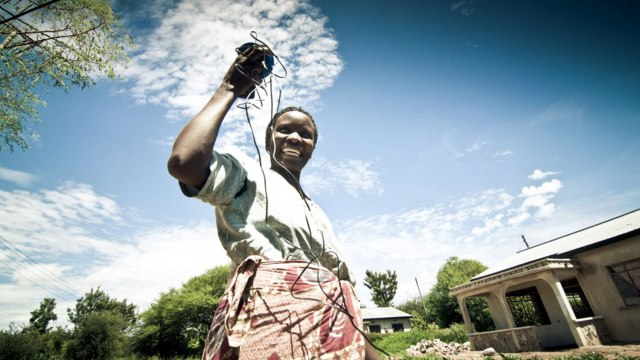happy African woman with cords