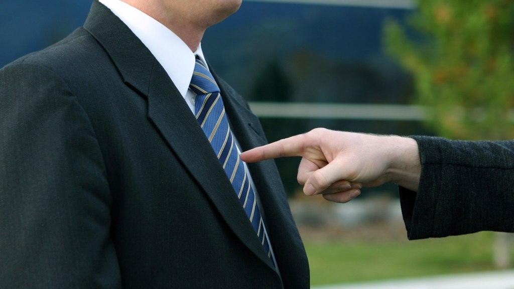 finger jabbing into man's chest