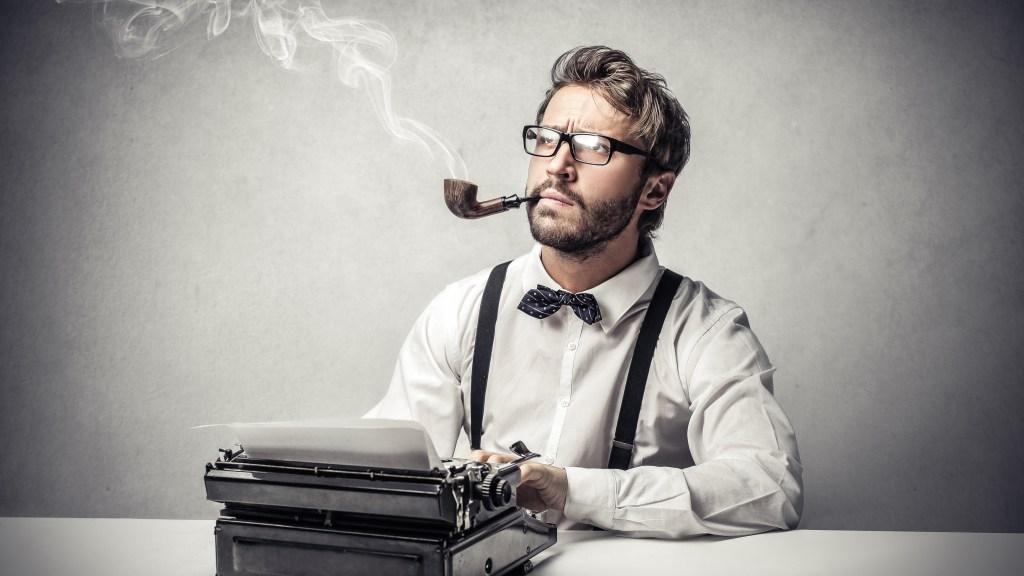 stereotypical journalist at typewriter