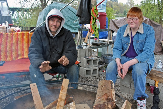 Chris Semrau and another Nickelsville resident warm themselves by a communal fire.