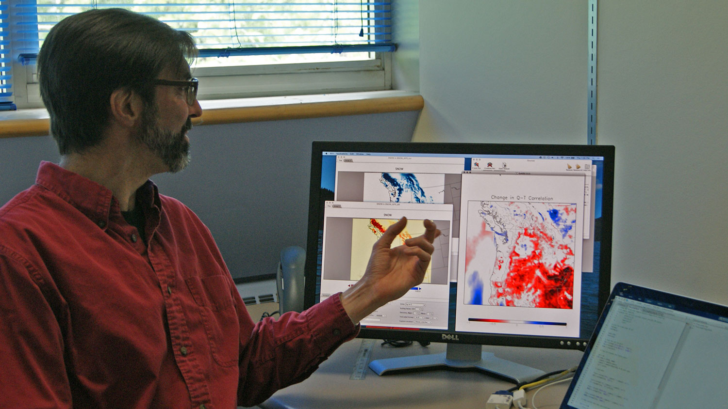 Eric Salathé, a professor of climate science at the University of Washington Bothell School of STEM, points to results from the WRF regional climate model.