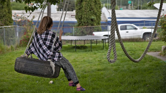 Lahrman's daughter Holland, 12, swings on the tire swing.