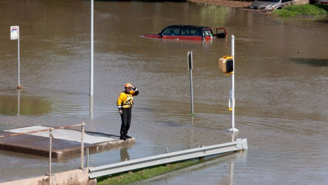 rescue worker on a flooded street