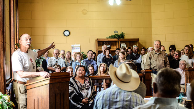 A lone pipeline supporter speaks to local officials and citizens at a county commissioners meeting in Marfa, Texas, on Tuesday.