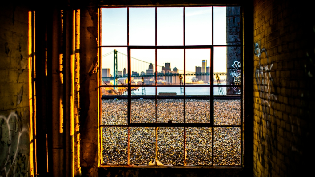 Detroit skyline through old window
