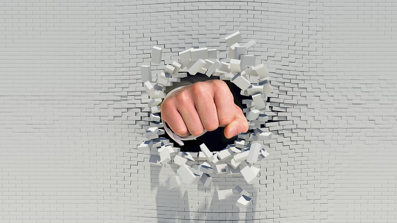 fist punching through wall