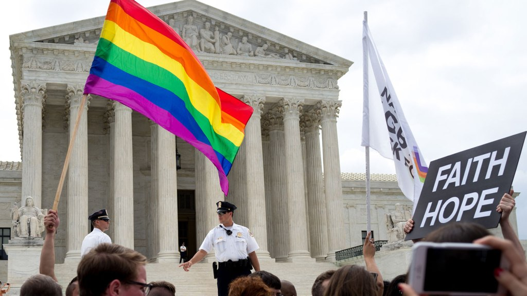 """gay pride flag and """"faith, hope"""" sign in front of Supreme Court"""