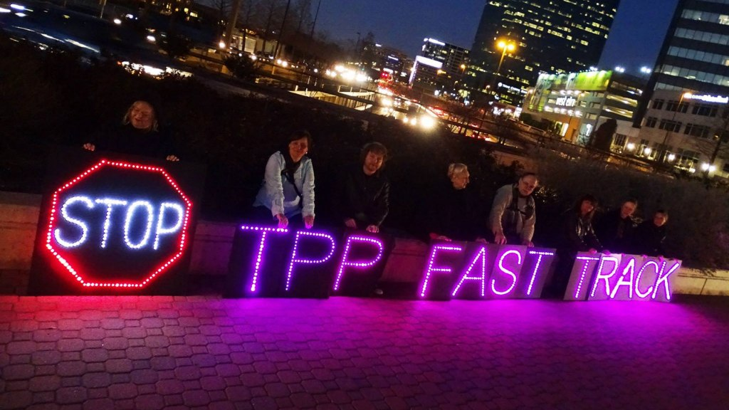 """activists' sign: """"Stop TPP Fast Track"""""""