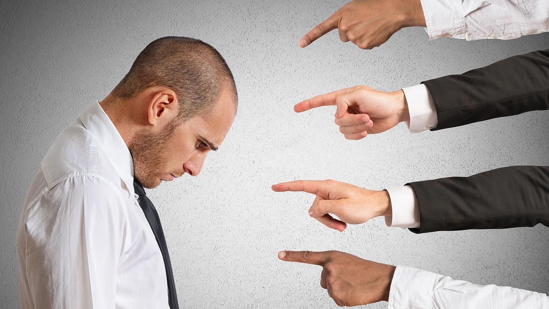 fingers pointing at shamed man