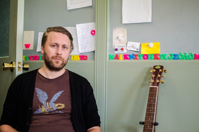 Daníel Auðunsson, the guitarist for the indie-folk band Árstíðir, who also works part-time managing Toppstöðin.