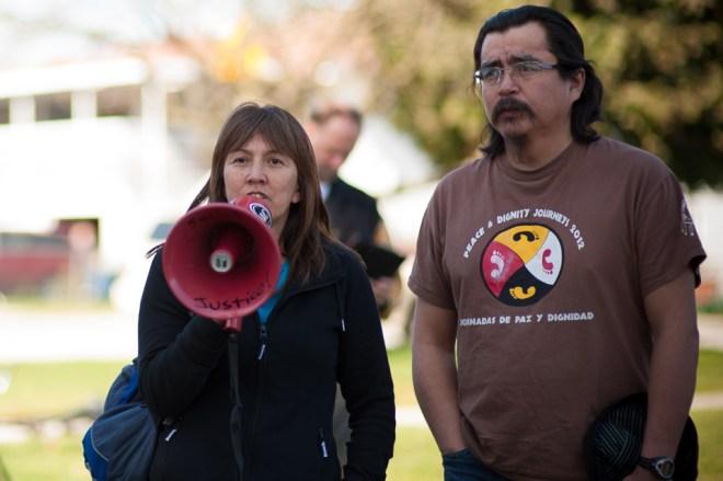 Freda Huson and Dini Ze Toghestiy at a Chevron protest in 2013.