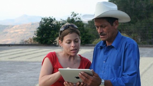 A Sustainable Harvest representative working with a farmer in Colombia