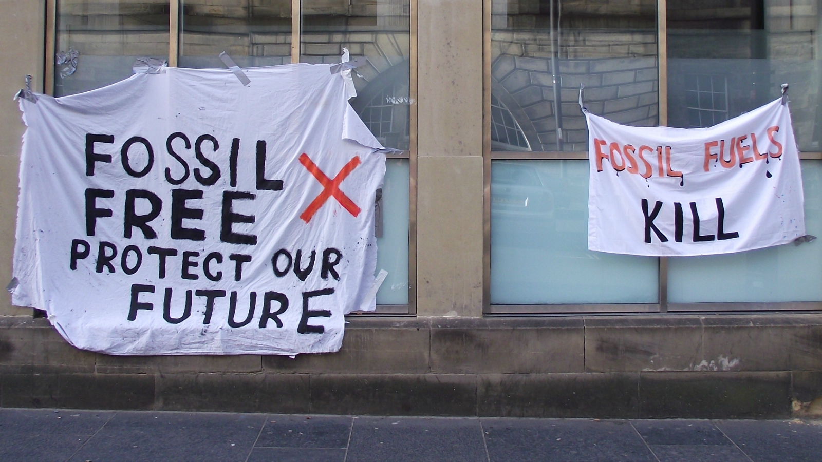 fossil fuel protest signs