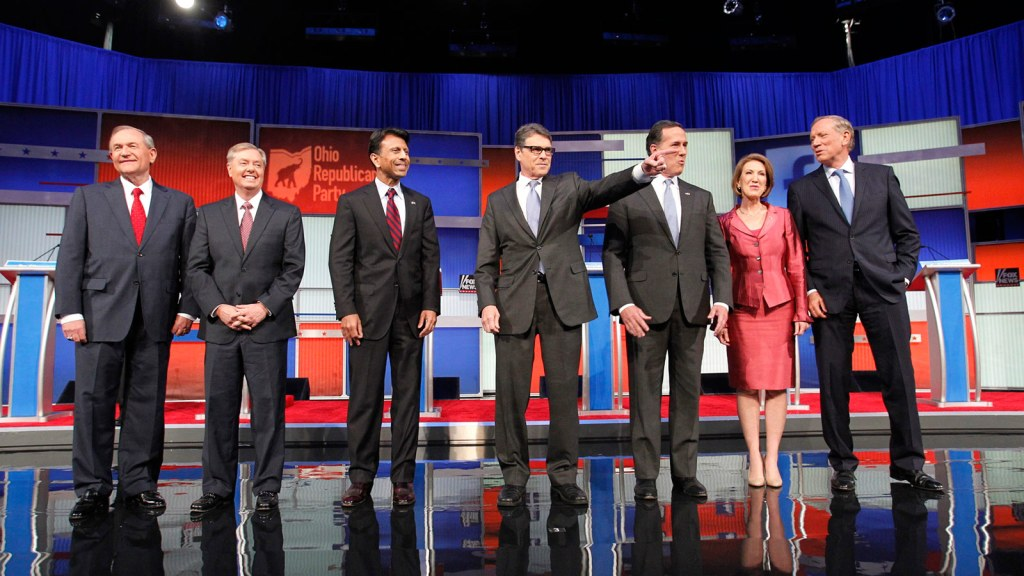 Republican presidential candidates (L-R), former Virginia Governor Jim Gilmore, U.S. Senator Lindsey Graham, Louisiana Governor Bobby Jindal, former Texas Governor Rick Perry, former U.S. Senator Rick Santorum, former HP CEO Carly Fiorina and former New York Governor George Pataki, pose before the start of a Fox-sponsored forum for lower polling candidates held before the first official Republican presidential candidates debate of the 2016 U.S. presidential campaign in Cleveland, Ohio, August 6, 2015.