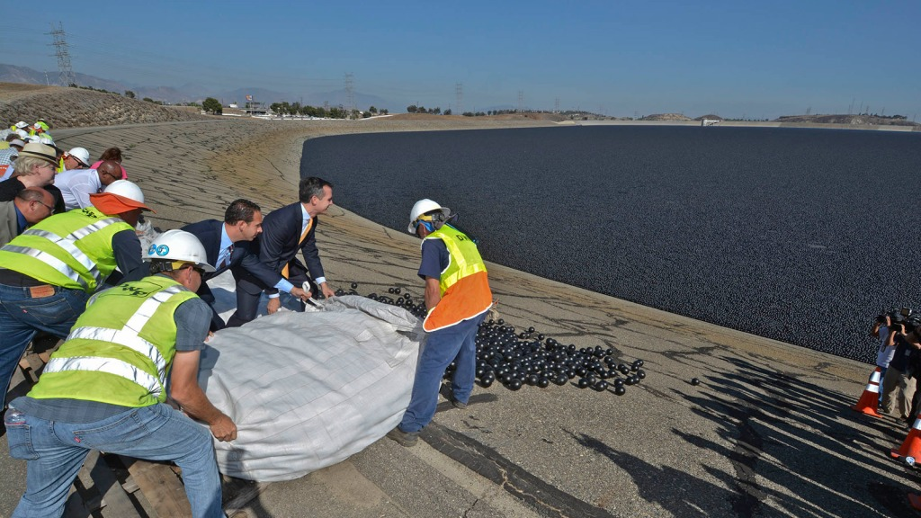 Council member Mitch Englander and LA Mayor Eric Garcetti along with LADWP workers releasing shade balls into the LA Reservoir