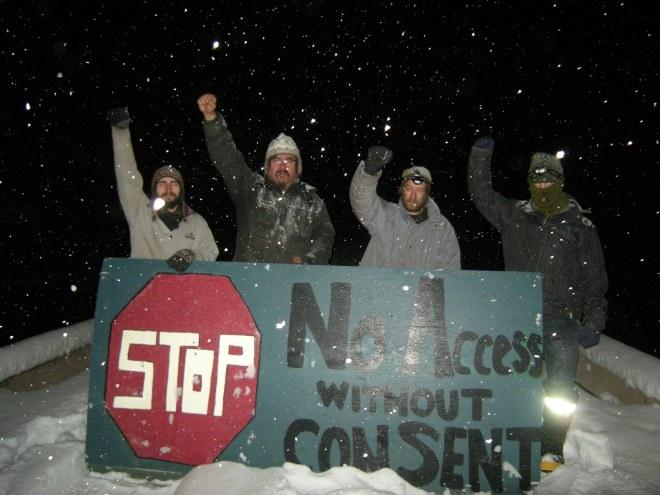 Camp members stop surveyors, Nov. 20, 2012.