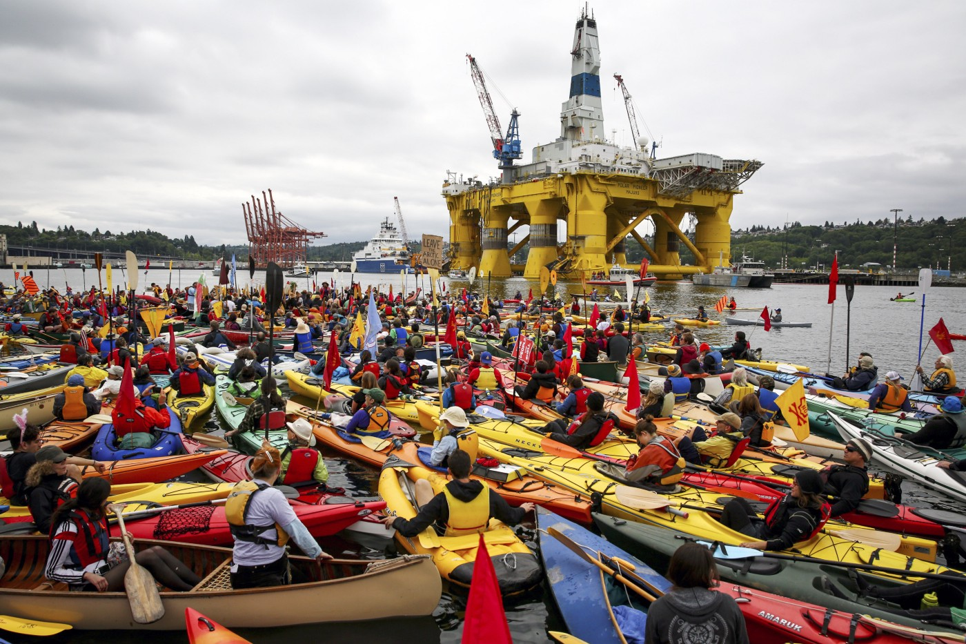 """Activists who oppose Royal Dutch Shell's plans to drill for oil in the Arctic Ocean prepare their kayaks for the """"Paddle in Seattle"""" protest on Saturday, May 16, 2015, in Seattle."""