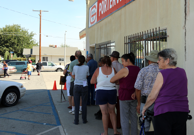 Residents line up to pick up emergency boxes of food.