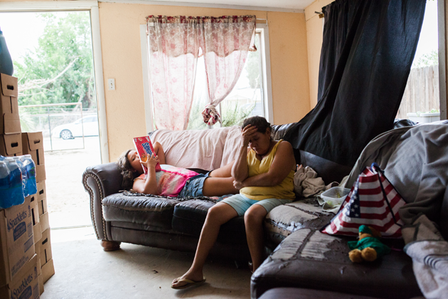 Juana Garcia, 49, and her daughter, Noemi Castro, 11, in their home in East Porterville, California. The family has had a dry well for the past two years.