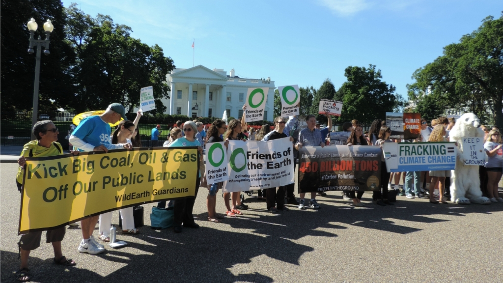 activists and banners in front of White House
