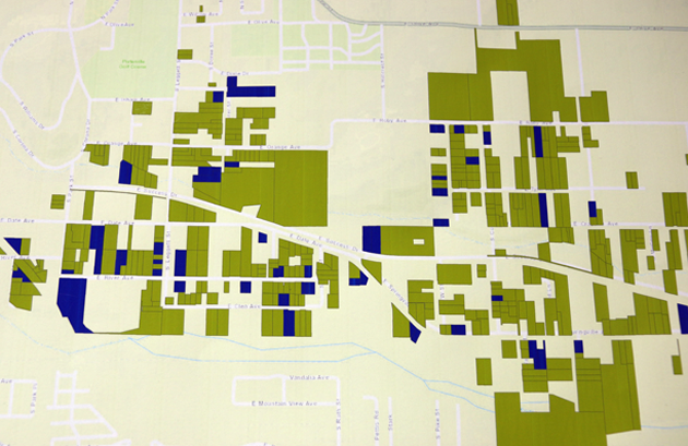 A map of East Porterville at the county's drought resource center shows homes without running water (green) and homes where large tanks have been installed as an interim solution (blue).