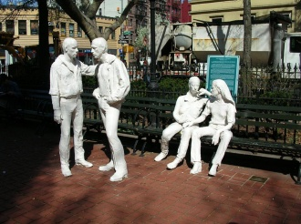 The Gay Liberation sculpture by George Segal in Christopher Park honoring the gay rights movement and commemorating the events at the Stonewall Inn opposite the park that gave rise to the movement.