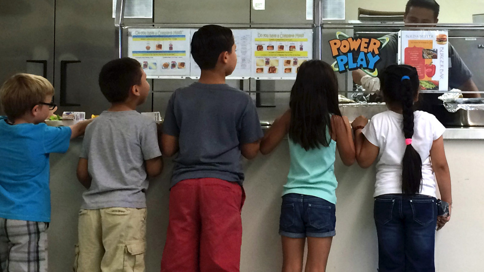 First graders at Washington Elementary School in Riverside, California, line up for hot food after choosing fruits and vegetables from the salad bar on October 13, 2015
