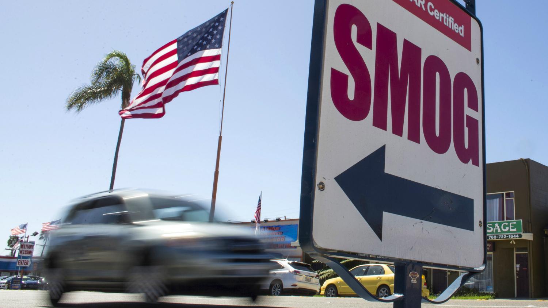 smog sign and flag