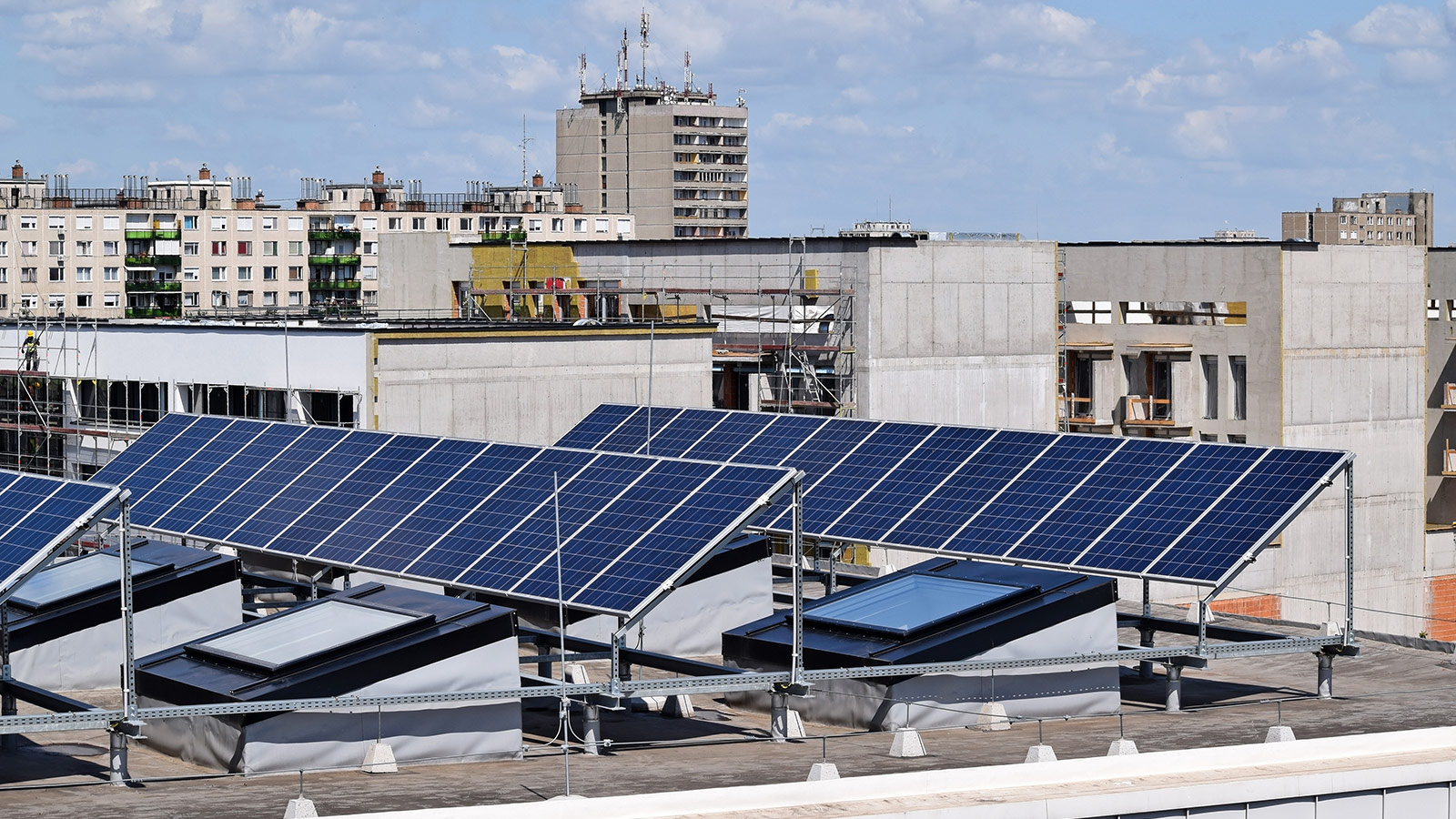 Solar panels on the rooftop of a multifamily building