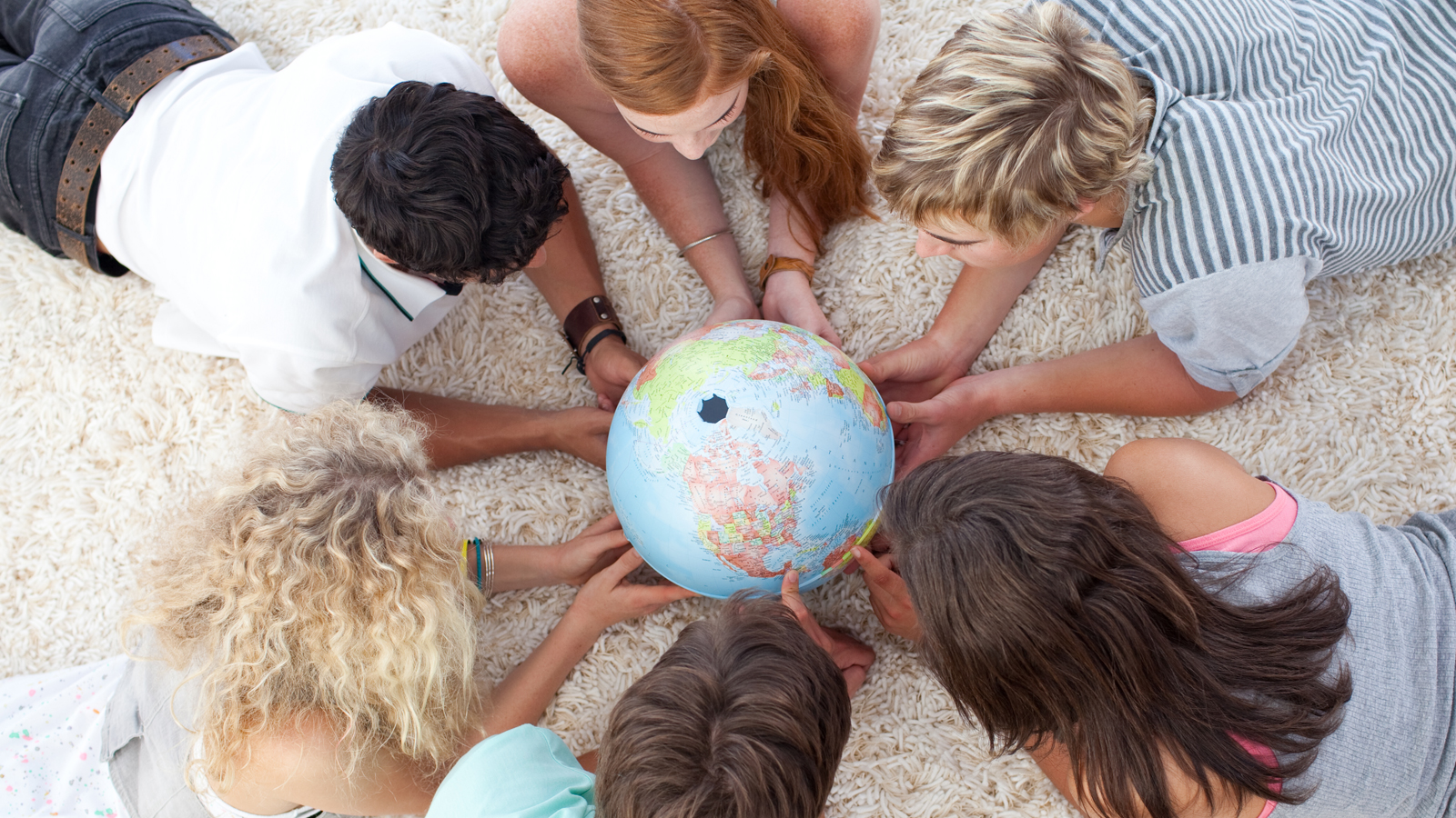 Teenagers with a globe