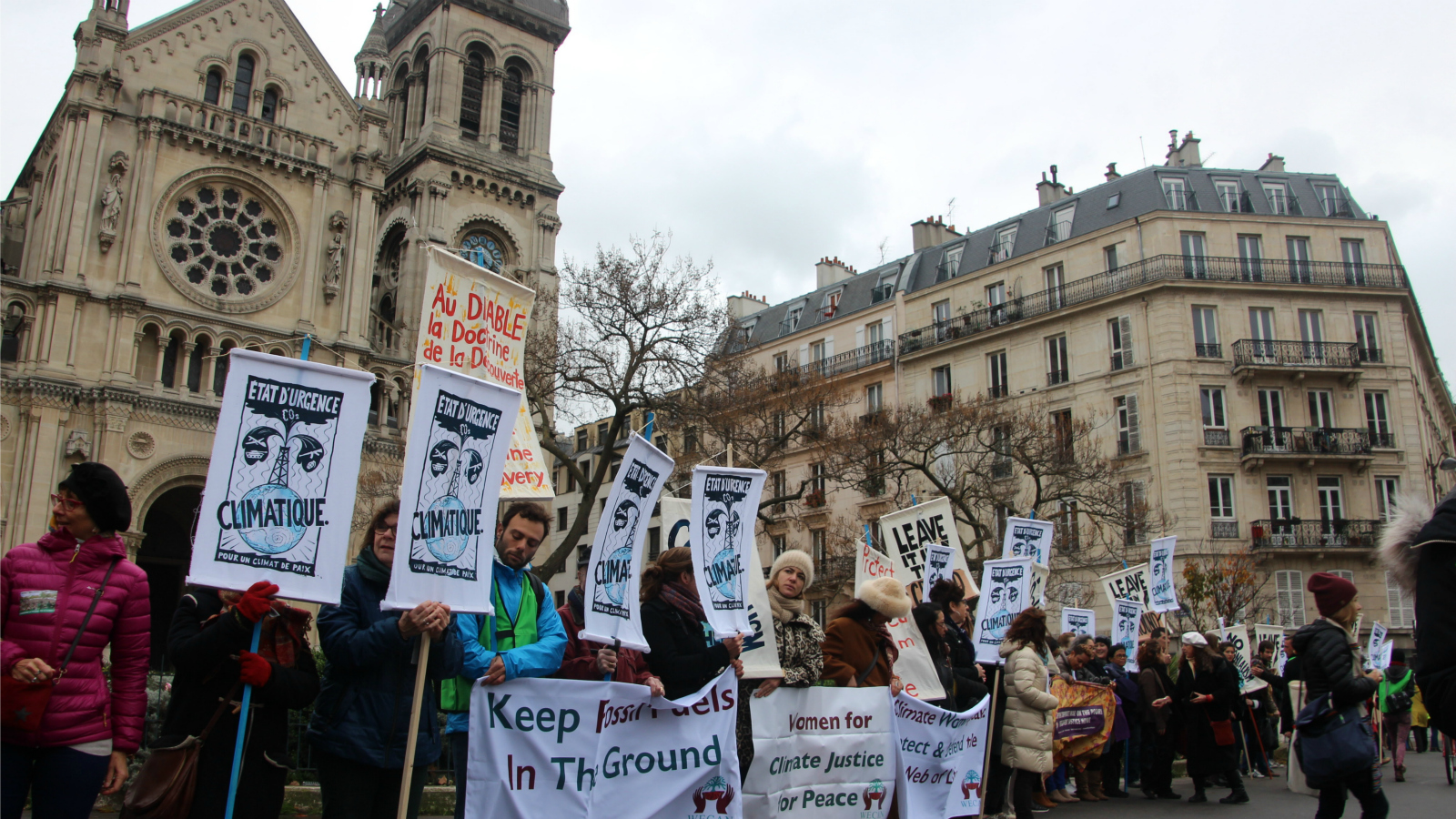 activists holding signs in Paris
