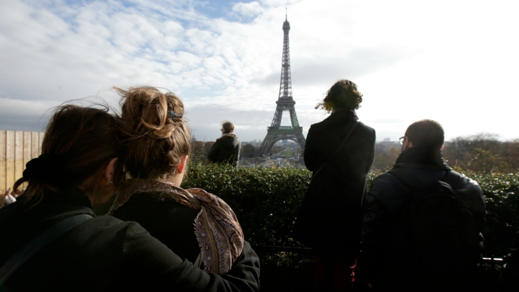 mourners in front of Eiffel Tower