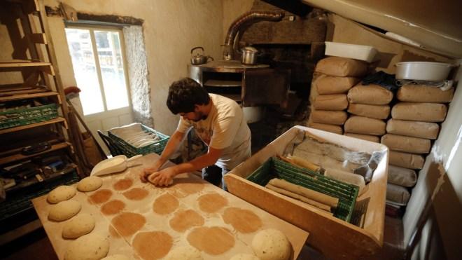 Baker Damien makes bread in western France.