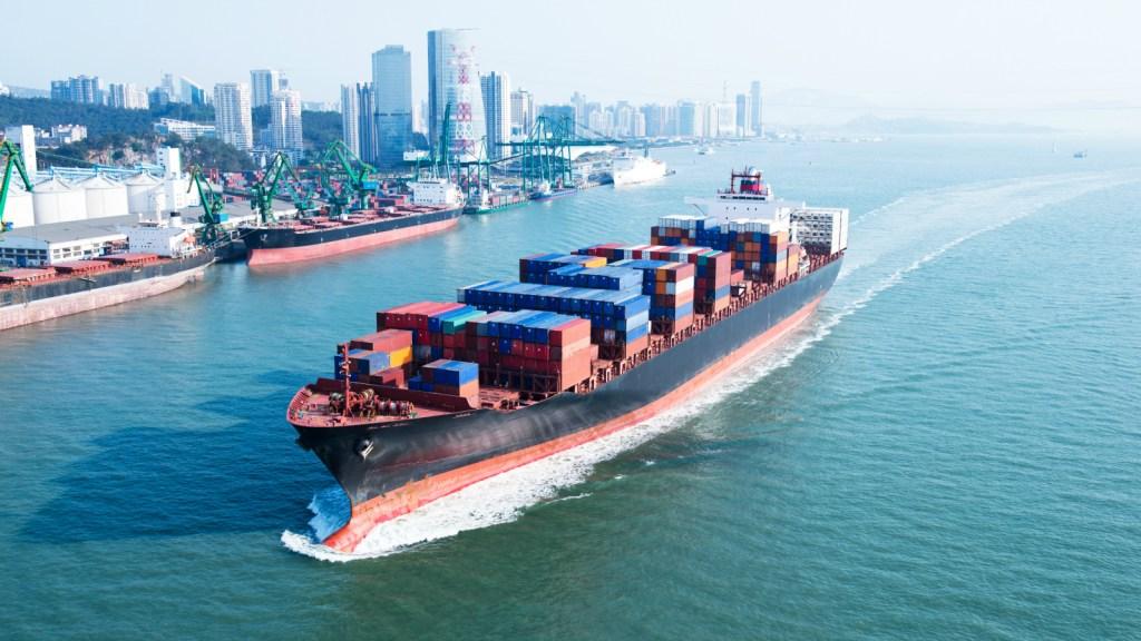 cargo ship near city